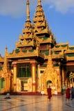 Pilgrims walking around Temples of Shwedagon Pagoda complex, Yan Royalty Free Stock Photography