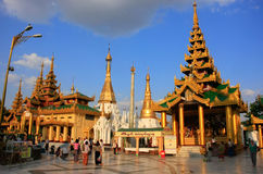 Pilgrims walking around Temples of Shwedagon Pagoda complex, Yan Royalty Free Stock Photos