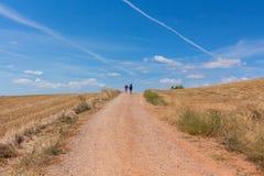 Pilgrims walking in the Camino de Santiago, Spain. Pilgrims in the Camino de Santiago St James way, close to the city of Najera, Spain royalty free stock photo