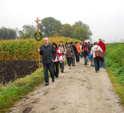 Pilgrims walking on a dirt road. Pilgrims walk on a dirt road heading for the town of Altötting in Germany Royalty Free Stock Image