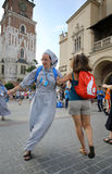 Pilgrims of World Youth Day sing and dance on the Main Square in Cracow stock image
