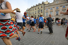 Pilgrims of World Youth Day sing and dance on the Main Square in  Cracow Royalty Free Stock Images