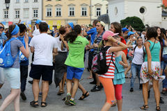 Pilgrims of World Youth Day sing and dance on the Main Square in  Cracow Royalty Free Stock Image