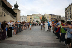 Pilgrims of World Youth Day sing and dance on the Main Square in  Cracow Royalty Free Stock Photo
