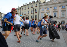 Pilgrims of World Youth Day sing and dance on the Main Square in  Cracow. Royalty Free Stock Photography