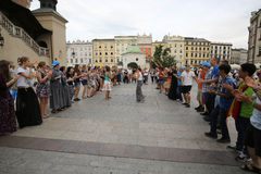 Pilgrims of World Youth Day sing and dance on the Main Square in  Cracow. Stock Photos
