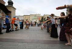 Pilgrims of World Youth Day sing and dance on the Main Square in  Cracow. Royalty Free Stock Photos