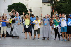 Pilgrims of World Youth Day sing and dance on the Main Square in  Cracow. Stock Photo