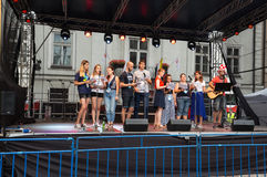 Pilgrims of World Youth Day sing and dance on the St. Maria Magdalena Square in  Cracow Royalty Free Stock Image