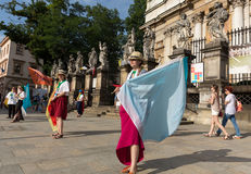 Pilgrims of World Youth Day sing and dance on the St. Maria Magdalena Square in  Cracow Royalty Free Stock Photography