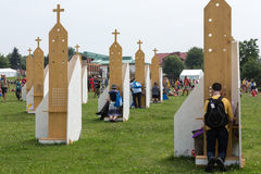 Pilgrims in Zone of Reconciliation at Sanctuary of Divine Mercy in Lagiewniki. WYD participants will be able to confess to more than 50 confessionals. Cracow Royalty Free Stock Photo