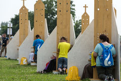 Pilgrims in Zone of Reconciliation at Sanctuary of Divine Mercy in Lagiewniki. WYD participants will be able to confess to more than 50 confessionals. Cracow stock images