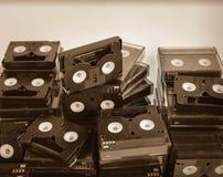 Pilha abandonada de mini DV inútil velho Fotos de Stock
