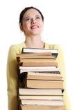 Pilha adolescente da terra arrendada da menina dos livros. Imagem de Stock Royalty Free