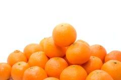 Pilha alaranjada brilhante e saboroso dos tangerins fotos de stock royalty free