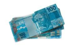 Pilha da moeda do brasileiro 100 100 reais Foto de Stock Royalty Free