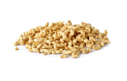 Pilha da proteína vegetal Textured no branco Foto de Stock Royalty Free