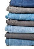 Pilha das calças de brim Fotos de Stock