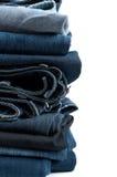 Pilha das calças de brim Fotografia de Stock Royalty Free