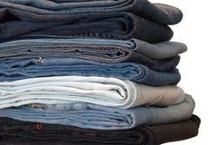 Pilha das calças de brim Foto de Stock