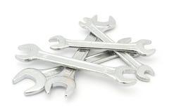 Pilha das chaves inglesas sobre o branco Fotos de Stock Royalty Free