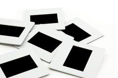 Pilha das corrediças com frames no llightbox. Imagens de Stock Royalty Free