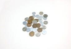 Pilha das moedas no fundo branco Fotografia de Stock