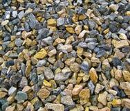 A pilha das pedras aproxima o canteiro de obras fotos de stock