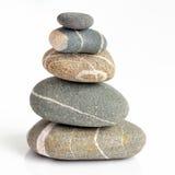 Pilha das pedras isoladas no fundo branco Imagem de Stock Royalty Free