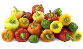 Pilha das pimentas coloridas isoladas Imagem de Stock Royalty Free