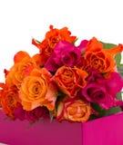 Pilha das rosas na caixa Imagens de Stock Royalty Free