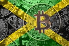 Pilha de bandeira de Bitcoin Jamaica Conceito dos cryptocurrencies de Bitcoin imagem de stock