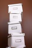 Pilha de caixas de armazenamento do escritório Foto de Stock