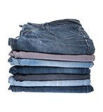 Pilha de calças de brim imagens de stock