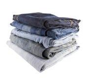 Pilha de calças de brim Fotos de Stock