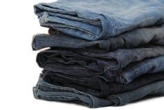 Pilha de calças de brim Fotografia de Stock