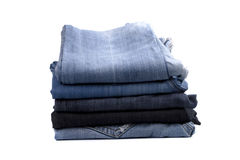 Pilha de calças de ganga Foto de Stock Royalty Free