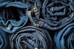 Pilha de calças de ganga como um fundo Foto de Stock Royalty Free