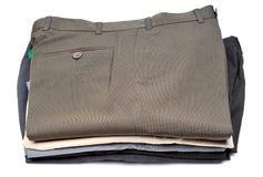 Pilha de calças formais fotos de stock