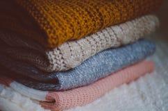 Pilha de camisolas Fotografia de Stock Royalty Free