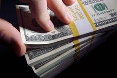 Pilha de cem contas de dólar Fotos de Stock