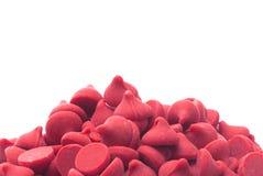 Pilha de Cherry Baking Chips vermelho gourmet imagem de stock royalty free