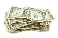 Pilha de contas de dólar amarrotadas Fotografia de Stock Royalty Free