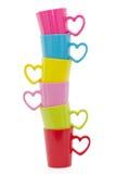 Pilha de copos coloridos, isolada Fotografia de Stock Royalty Free