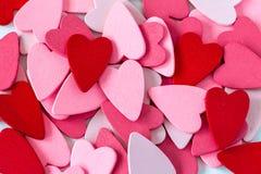 Pilha de corações vermelhos e cor-de-rosa Foto de Stock