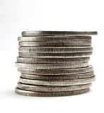 Pilha de dólares e de moedas imagens de stock