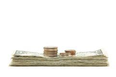 Pilha de dinheiro & de moedas Imagem de Stock