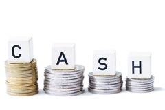 A pilha de dinheiro com o dinheiro da palavra isolou o fundo branco Foto de Stock Royalty Free