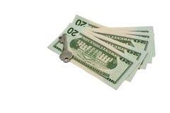 Pilha de dinheiro com uma chave Fotografia de Stock