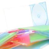 Pilha de discos no fundo branco Imagens de Stock Royalty Free
